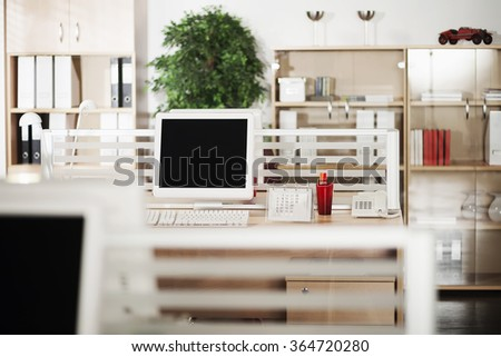 Computers with LCD screens in modern office - stock photo