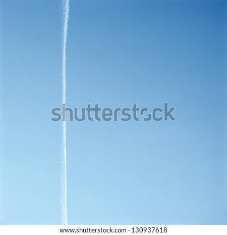 Con trail in the blue sky - stock photo