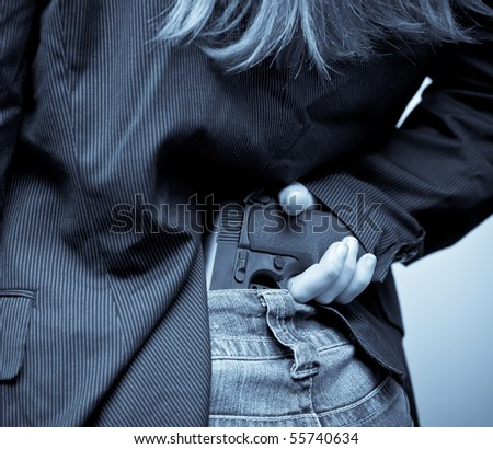 Concealing a Weapon - stock photo