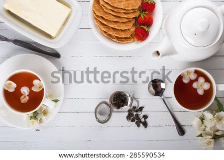 Conceived with a cup of tea on a white surface - stock photo