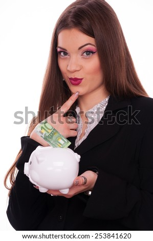 Conceived young brunette put hundred Euro bill in the piggy bank, on white background - stock photo