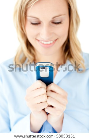 Concentrated blond woman sending a text against white background - stock photo