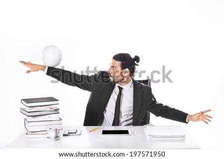 concentrated business man playing football in office - stock photo