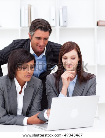 Concentrated business partners working at a computer in the office