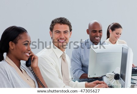 Concentrated business team at work in the office - stock photo