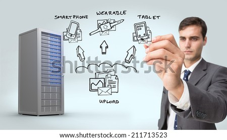 Concentrated businessman holding red marker against digitally generated server tower