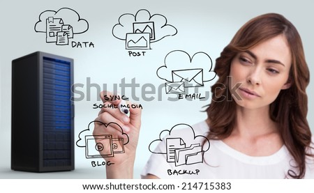 Concentrated businesswoman holding whiteboard marker against digitally generated black server tower