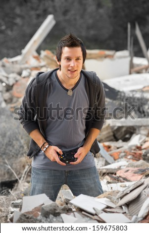 Concentrated gamer enjoying his hobby in gloomy surroundings, a concept