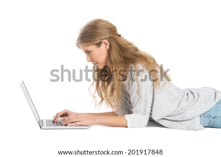 Concentrated Girl Lying Using Laptop Isolated On White Background
