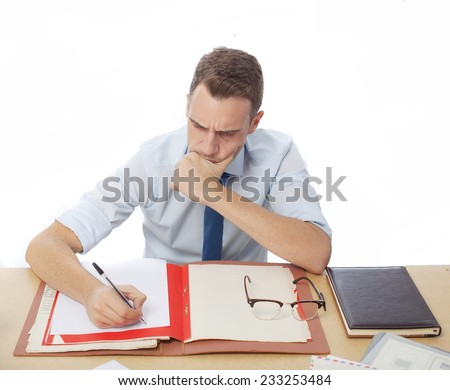 concentrated man in office desk writting - stock photo