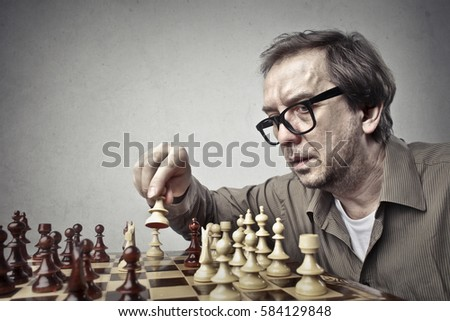 Concentrated man playing chess