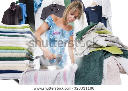 Concentrated woman is ironing many clothes, from the iron out of steam