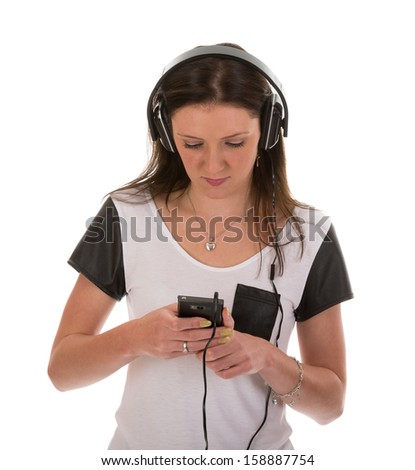 Concentrated woman with headphones listening to music of her telephone
