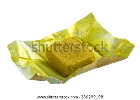 Concentrates chicken flavor bouillon cube isolated over white background with clipping path - stock photo