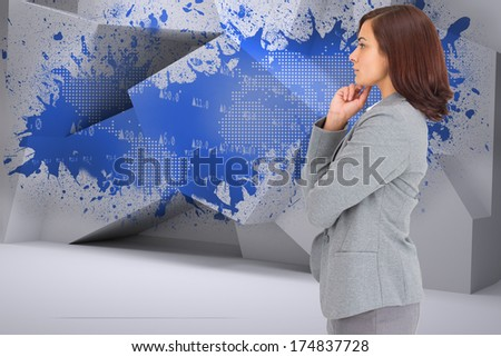 Concentrating businesswoman against splash showing earth graphic - stock photo