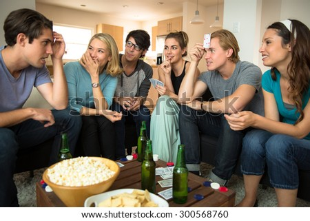 Concentrating card players game night friends group attractive people handsome men beautiful women - stock photo