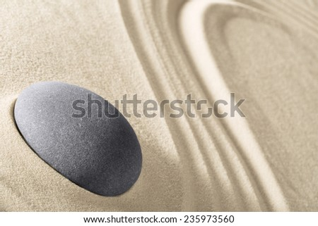 concentration and spirituality in Japanese zen garden spa background with stone and lines in sand concept for meditation and relaxation - stock photo