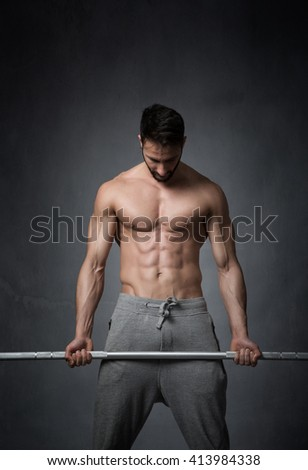 concentration before sport, dark background - stock photo