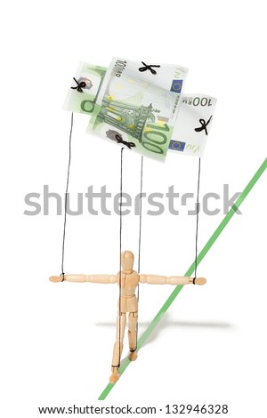 concept, a puppet controlled by money - stock photo