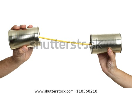 Concept about communications with 2 tin cans and a string, in white background, isolated.