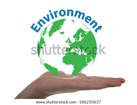 Concept about environment through a globe on a hand