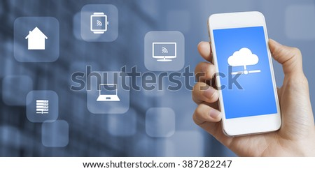Concept about the technology of internet of things, female hand holding a smartphone connected to the cloud with online access to everything on the network