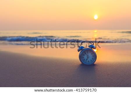 Concept alarm clock on beach of island, thailand.monochrome filter - stock photo