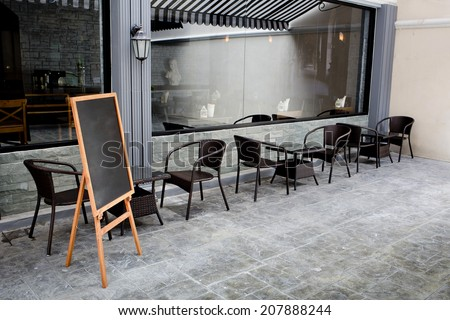 Concept and design front of Coffee Shop with black board and black seating - stock photo
