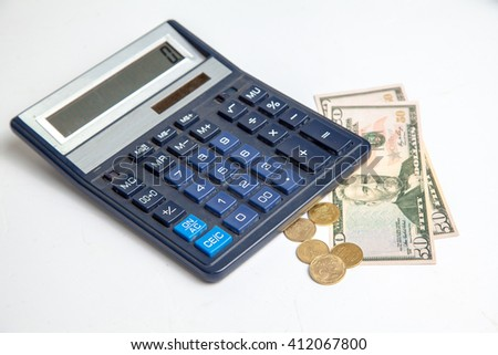 Concept art of the financial crisis. a small amount of money of counted a calculator - stock photo