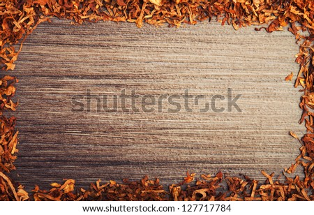 Concept background against smoking. Framed with tobacco on wooden background - stock photo
