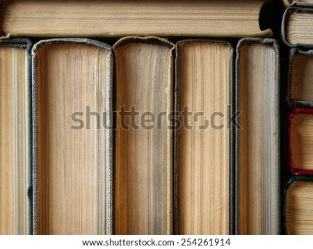 Concept background made of old books arranged in well-ordered close stacks - stock photo