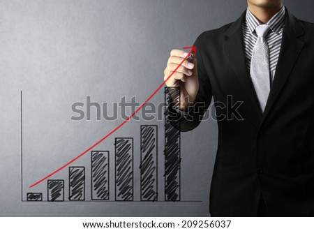 concept business man writing over target graph