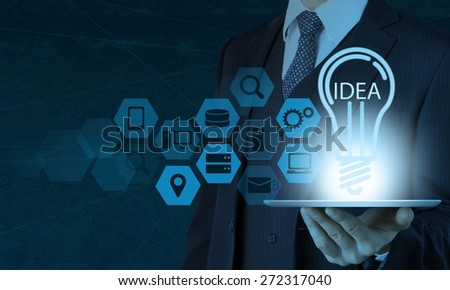 Concept. Businessman hand draws lightbulb with new computer interface as solution business concept - stock photo
