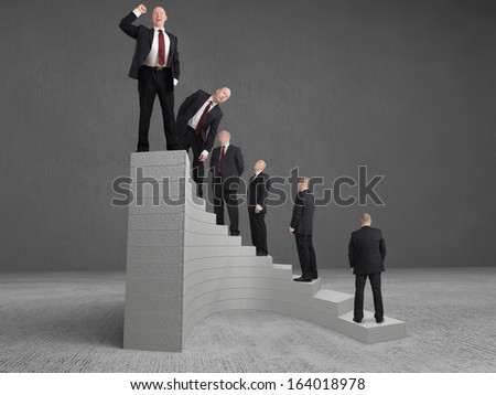 concept Businessman reaching the top - stock photo