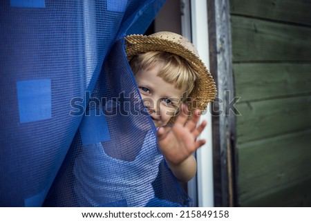 Concept: Bye, Summer! Outdoor portrait:  beautiful kid smiling and waving