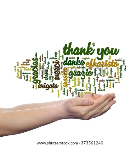 Concept conceptual abstract thank you word cloud held in hands in different languages or multilingual for education Thanksgiving Day metaphor to appreciation, multicultural, friendship, tourism travel - stock photo