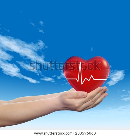 Concept conceptual 3D red human heart sign or symbol held in human man or woman hand, blue sky background, metaphor to health, care, medicine, protect, life, medical, pulse, healthcare cardiology
