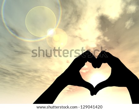 Concept conceptual heart shape or symbol made of human or woman and man hand silhouette over a sky at sunset background, metaphor to love, valentine, romantic, couple, wedding, romance, summer sunrise
