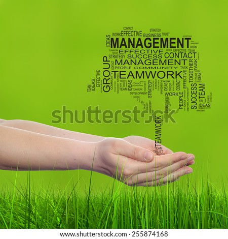 Concept conceptual text word cloud on man hand, tagcloud on green blur background and grass, metaphor to business, team, teamwork, win, management, effective, success, communication, company or group - stock photo