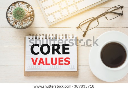 Concept CORE VALUES message on book. A keyboard and a glass coffee table.Vintage tone. - stock photo