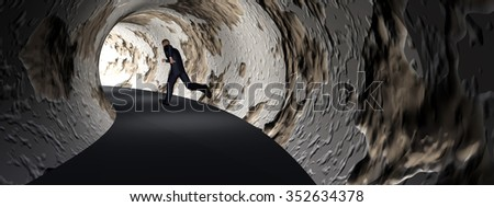 Concept 3D business man, dark road tunnel with bright light at the end background banner metaphor to hope, freedom, exit, life, faith, motion, speed, dream, success, vision, future, fear or salvation - stock photo