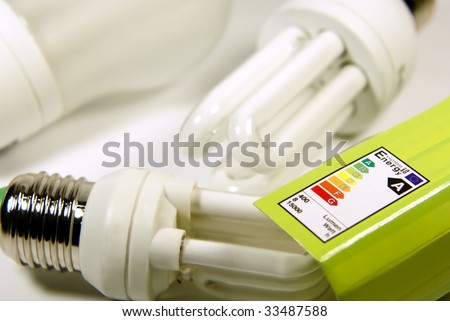 Concept dealing with energy saving by energy saving lamps. - stock photo