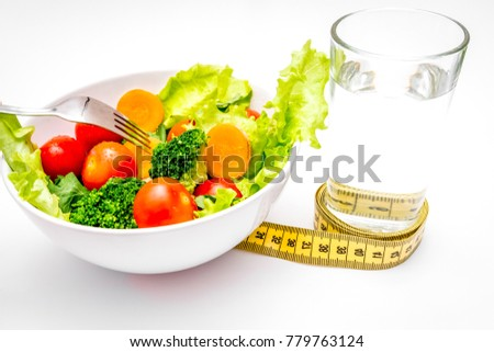 concept diet fresh vegetables on plate at white background