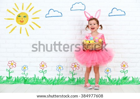 concept easter. Happy child girl in a costume bunny rabbit with ears and a basket of eggs - stock photo