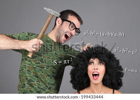 Concept - Education, Learning, Tutor. Putting information in head. A man is hammering nails into a girl's head. - stock photo