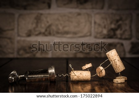 Concept escape from a corkscrew with wine cork figures - stock photo