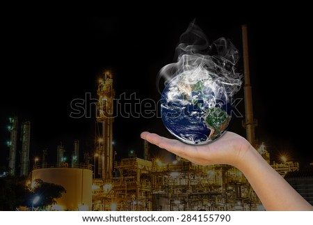 Concept: Expression of factories that cause pollution to the world. Hand helped the world. Elements of this image furnished by NASA  - stock photo
