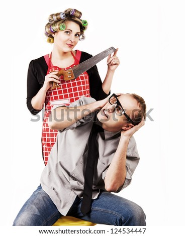 Concept family scene. Defaulter husband and wife with hacksaw