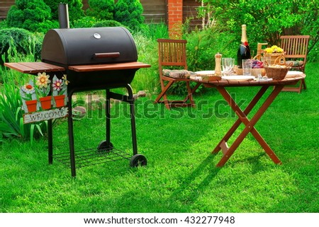 Concept For BBQ Or Picnic Party Scene With Charcoal Grill Served Table Bottle