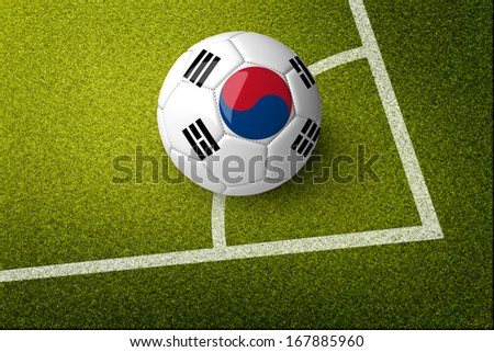 Concept for Brazil 2014 football championship. A soccer ball on green field with Korea flag on it. - stock photo